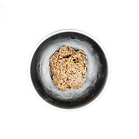 A bowl of ground peanuts, the oily paste is left to dry in the midday sun and used as a flavouring for bland food. Women grind and mix the peanuts with their bare hands often making enough to last them a whole year. A small bag of peanuts costs 25 CFA (GBP 0.03p) from Meme market.<br /> The extreme north of Cameroon is suffering a food shortage exacerbated by climate change and conflict with Boko Haram. Fighting has spread across the borders from Nigeria into the countries of the Lake Chad region creating a refugee and famine crisis. Once an intrepid tourist destination boasting Waza national park, the extreme north of Cameroon now hosts people fleeing violence housed in unnamed refugee camps where they are lucky if they manage to get a single meal each day.