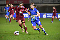 Lyndsey Van Belle (14) of AA Gent and Lorene Martin (4) of KRC Genk pictured during a female soccer game between  AA Gent Ladies and Racing Genk on the 12 th matchday of the 2020 - 2021 season of Belgian Scooore Womens Super League , friday 29 th of January 2021  in Oostakker , Belgium . PHOTO SPORTPIX.BE | SPP | DIRK VUYLSTEKE