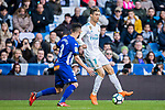 Cristiano Ronaldo (R) of Real Madrid is tackled by Ruben Duarte of Deportivo Alaves during the La Liga 2017-18 match between Real Madrid and Deportivo Alaves at Santiago Bernabeu Stadium on February 24 2018 in Madrid, Spain. Photo by Diego Souto / Power Sport Images