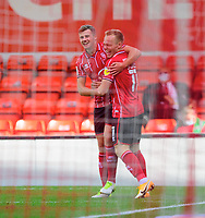 Lincoln City's Anthony Scully, right, celebrates scoring the opening goal with team-mate James Jones<br /> <br /> Photographer Chris Vaughan/CameraSport<br /> <br /> The EFL Sky Bet League One - Saturday 12th September 2020 - Lincoln City v Oxford United - LNER Stadium - Lincoln<br /> <br /> World Copyright © 2020 CameraSport. All rights reserved. 43 Linden Ave. Countesthorpe. Leicester. England. LE8 5PG - Tel: +44 (0) 116 277 4147 - admin@camerasport.com - www.camerasport.com - Lincoln City v Oxford United