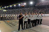 Crews pause for the National Anthem.