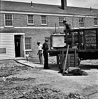 First Black family moving into the Sojourner Truth neighborhood, Detroit, Michigan, 1942.<br /> <br /> Photo by Arthur S. Siegel.