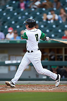 Zack Collins (8) of the Caballeros de Charlotte follows through on his swing against the Buffalo Bisons at BB&T BallPark on July 23, 2019 in Charlotte, North Carolina. The Bisons defeated the Caballeros 8-1. (Brian Westerholt/Four Seam Images)
