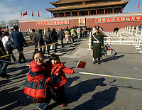 Police guard the Gate of Heavenly Peace, the entrance to the Forbidden City opposite Tiananmen Square, China. Security in the capital is increasingly tight in the runup to the opening of the Olympic Games..29 Feb 2008