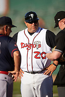 Lansing Lugnuts manager Ken Huckaby (20) during the lineup exchange before a game against the Peoria Chiefs on June 6, 2015 at Cooley Law School Stadium in Lansing, Michigan.  Lansing defeated Peoria 6-2.  (Mike Janes/Four Seam Images)