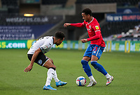20th April 2021; Liberty Stadium, Swansea, Glamorgan, Wales; English Football League Championship Football, Swansea City versus Queens Park Rangers; Chris Willock of Queens Park Rangers takes on Korey Smith of Swansea City