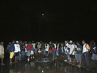 leatherback turtle, Dermochelys coriacea, makes its way to the sea, surrounded by people, Londonderry Bay, Dominica, Windward Islands