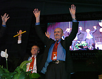 Arkansas Democrat-Gazette/MICHAEL WOODS<br /><br />Former University of Arkansas track and field coach John Mc Donnell and University of Arkansas athletic director Jeff Long call the hogs during the Thursday evening tribute to the legendary Arkansas coach at the Tyson indoor Track  in Fayetteville.<br /><br />09/18/08