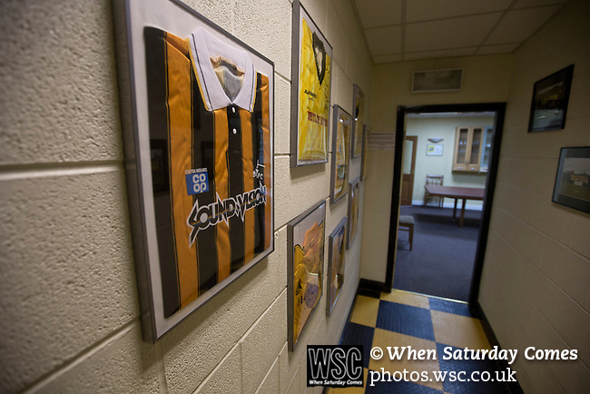 Belper Town v Gresley, 28/01/2014. Christchurch meadow, Northern Premier League. Framed football strips displayed on a corridor wall outside the board room before Belper Town's match against Gresley, in a Northern Premier League, first division south fixture at Christchurch meadow. The home side have played at their current ground since the club was reformed in 1951. Belper won this fixture against their local Derbyshire rivals by 4 goals to 1 watched by a crowd of 165 spectators. Photo by Colin McPherson.