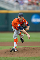 Cal State Fullerton Titans pitcher Thomas Eshelman (15) follows through on a pitch to the plate during the NCAA College baseball World Series against the Vanderbilt Commodores on June 14, 2015 at TD Ameritrade Park in Omaha, Nebraska. The Titans were leading 3-0 in the bottom of the sixth inning when the game was suspended by rain. (Andrew Woolley/Four Seam Images)