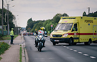 a good minute after the breakaway group has passed and with the peloton just 10 seconds out, an ambulance with flashing warning lights and sirens on, suddenly enters the race course... and is now de facto part of the race (after following the race course for a few kilometers, it will eventually leave the course and will have had no influence on the race itself)<br /> <br /> 98th Brussels Cycling Classic 2018<br /> One Day Race:  Brussels > Brussels (201km)