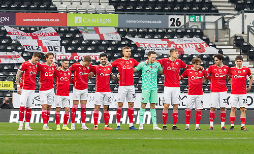 7th November 2020; Pride Park, Derby, East Midlands; English Football League Championship Football, Derby County versus Barnsley; Barnsley players along with match officials stand silent on the centre circle prior to the kick off to pay their respects as part of Remembrance Sunday on 8th November 2020