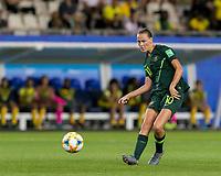 GRENOBLE, FRANCE - JUNE 18: Emily Van Egmond #10 of the Australian National Team passes the ball during a game between Jamaica and Australia at Stade des Alpes on June 18, 2019 in Grenoble, France.