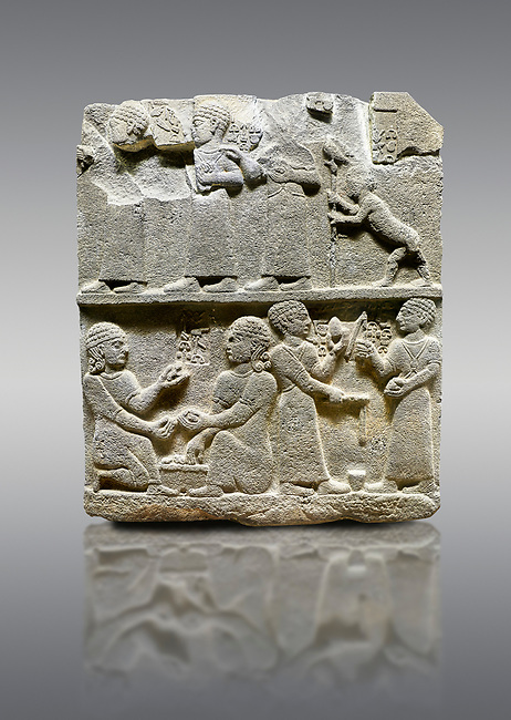 """Picture & image of Hittite monumental relief sculpted orthostat stone panel of Royal Buttress. Basalt, Karkamıs, (Kargamıs), Carchemish (Karkemish), 900 - 700 B.C. Anatolian Civilisations Museum, Ankara, Turkey.<br /> <br /> This panels scene showing 8 out of 10 children of the King, the hieroglyphs reads as follows: """"Malitispas, Astitarhunzas, Tamitispas,Isikaritispas, Sikaras, Halpawaris, Ya hilatispas"""". Above, there are three figures holding knucklebones (astragalus) and one figure walking by leaning on a stick; below are two each figures playing the knucklebones and turning whirligigs.  <br /> <br /> Against a gray background."""
