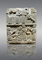 "Picture & image of Hittite monumental relief sculpted orthostat stone panel of Royal Buttress. Basalt, Karkamıs, (Kargamıs), Carchemish (Karkemish), 900 - 700 B.C. Anatolian Civilisations Museum, Ankara, Turkey.<br /> <br /> This panels scene showing 8 out of 10 children of the King, the hieroglyphs reads as follows: ""Malitispas, Astitarhunzas, Tamitispas,Isikaritispas, Sikaras, Halpawaris, Ya hilatispas"". Above, there are three figures holding knucklebones (astragalus) and one figure walking by leaning on a stick; below are two each figures playing the knucklebones and turning whirligigs.  <br /> <br /> Against a gray background."