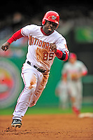 13 April 2009: Washington Nationals' outfielder Lastings Milledge hustles to third against the Philadelphia Phillies during the Nats' Home Opener at Nationals Park in Washington, DC. The Nats fell short in their 9th inning rally, losing 9-8, and marking their 7th consecutive loss of the 2009 season. Mandatory Credit: Ed Wolfstein Photo