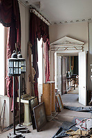 Every room in the house is filled with abandoned and missplaced furniture and objects, presenting a daunting task before the interior can be restored