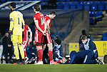 St Johnstone v Aberdeen…27.01.21   McDiarmid Park   SPFL<br />Tommy Hoban is treated after a clash of heads with Ross McCrorie<br />Picture by Graeme Hart.<br />Copyright Perthshire Picture Agency<br />Tel: 01738 623350  Mobile: 07990 594431