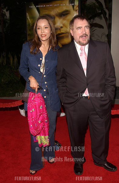 Actor BRIAN COX & actress BARBARA CARRERA at the world premiere, in Hollywood, of his new movie The Bourne Supremacy..July 15, 2004