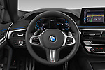 Car pictures of steering wheel view of a 2021 BMW 5-Series 530e-Edition-M-Sport 4 Door Sedan Steering Wheel