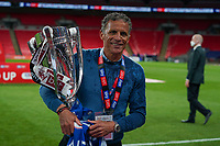 Northampton Town manager Keith Curle celebrates promotion to League One with the trophy after a 4-0 victory in the Sky Bet League 2 PLAY-OFF Final match between Exeter City and Northampton Town at Wembley Stadium, London, England on 29 June 2020. Photo by Andy Rowland.
