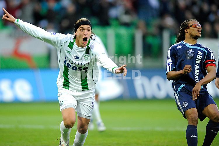 voetbal fc groningen - ajax erediivisie seizoen 2007-2008 16-04-2008  .matias cahais juicht na de 1-1 edgar davids baalt.fotograaf Jan Kanning
