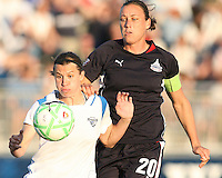 Abby Wambach #20 of the Washington Freedom gets a hand on Amy LePelbet #6 of the Boston Breakers during a WPS match at the Maryland Soccerplex, in Boyd's, Maryland, on April 18 2009. Breakers won the match 3-1.