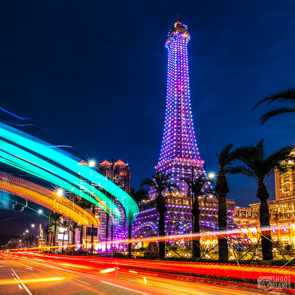Colorful, lit up Eiffel Tower during twilight, with beautiful traffic light trails, at the replica by the Vegas Parisian casino, in Macao, China