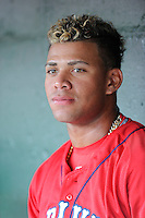 Second baseman Yoan Moncada (24) of the Greenville Drive is pictured in the dugout before a game against the Augusta GreenJackets on Thursday, June 11, 2015, at Fluor Field at the West End in Greenville, South Carolina. The Cuban-born 19-year-old Red Sox signee has been ranked the No. 1 international prospect in baseball by Baseball America. Greenville won, 10-1. (Tom Priddy/Four Seam Images)