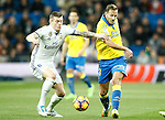 Real Madrid's Toni Kroos (l) and UD Las Palmas' Dani Castellano during La Liga match. March 1,2017. (ALTERPHOTOS/Acero)
