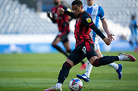 13th April 2021; The John Smiths Stadium, Huddersfield, Yorkshire, England; English Football League Championship Football, Huddersfield Town versus Bournemouth; Arnaut Danjuma of Bournemouth crosses and sets up the opening goal for Philip Billing of Bournemouth in the 15th minute