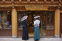 Diqing Tibetan Autonomous Prefecture, Yunnan Province, China - Tibetan and Han Chinese women try on traditional Tibetan costumes, August 2018.