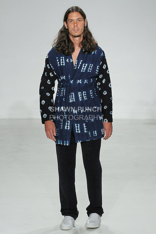Model walks runway in an African indigo mud cloth neneko and navy alpaca como trouser, from the Palmiers du Mal Spring Summer 2017 collection by Brandon Capps and Shane Fonner, at Skylight Clarkson Square on July 14 2016, during New York Fashion Week Men's Spring Summer 2017.