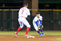 Scottsdale Scorpions second baseman Andres Gimenez (13), of the New York Mets organization, flips a ball to shortstop Arquimedes Gamboa (7), of the Philadelphia Phillies organization, to start a double play during an Arizona Fall League game against the Surprise Saguaros at Scottsdale Stadium on October 15, 2018 in Scottsdale, Arizona. Surprise defeated Scottsdale 2-0. (Zachary Lucy/Four Seam Images)