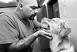 BEACON, NEW YORK:  Phil, in prison for manslaughter, works intensely with Jack to teach him to hold objects he fetches as part of the training in Puppies Behind Bars program at Fishkill Correctional Facility. Phil says that Jack is very hard-headed and stubborn at times so he has to give commands in a stern voice, but he acknowledges that it has taken the puppy less time to learn the commands than it's taken him to learn how to teach them. The program works with prison inmates in New York, New Jersey, and Connecticut to train service dogs, including ones who help injured soldiers or those suffering from post-traumatic stress. The puppies live with the prisoners during a 18-24-month training process.
