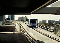 Cars of the Metromover transit system crossing the Miami River, seen from Riverwalk Station. Mass transit, monorail, public transportation, railroads, cityscape, skyline. Miami Florida, downtown Miami.