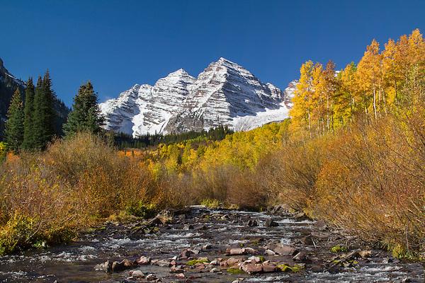 Maroon Creek with autumn Aspen trees, Maroon Bells Peaks, Aspen, Colorado, John offers autumn photo tours throughout Colorado.