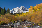Maroon Creek with autumn Aspen trees, Maroon Bells Peaks, Aspen, Colorado, John offers autumn photo tours throughout Colorado.