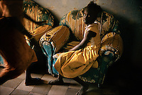 Dinka Slave Girl.In the limbo of a Khartoum transit center, a Dinka girl abducted from her village awaits return south.  Stung by charges of slavery, SudanÕs government has allowed hundreds of abducted women and children to be reunited with their families.  But thousands remain in the north while abductions continue, carried out by Baggara herders from SudanÕs drought-prone west.  Playing on Baggara-Dinka tensions over pastureland, the government arms Baggara horsemen to ride south with army resupply trains, raiding Dinka villages as they go...Story Summary:.Sudan, the largest country in Africa, hosts a civil war between the Islamic North and the African South that has the highest casualty rate of any war since World War II...Two and a half million people have been killed in this insidious conflict.  It drags on because Southerners have no voice, and the Northerners have engineered ÒThe Perfect WarÓ where none of their people are killed...The North forces people out of the South by bombing them, burning their crops, and harassing them with gun ships. They abduct their children and draft them to fight with the Northern armyÑforcing southerners to fight their own brothers...This story is particularly interesting now because there is a small window for peace in a civil war that has been dragging on since the end of colonial rule.  The war has always been about tribal issues and ideologyÉ but more than that, it is about resources.  This clash over resources may bring peace.  The North controls the pipeline and the only port, and the South controls the land...The story of Sudan has always been the continual transference of wealth from the resources of the south to the elite few who live in the deserts of the north.  And the sucking sound in the middle of the country is from the corrupt government in northern Khartoum..