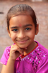 This bright young girl asked to have her photo taken when she was by the Ganges River