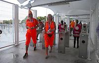 Netherlands supporters in bright orange fancy dress arrive at the Arena Fonte Nova, Salvador