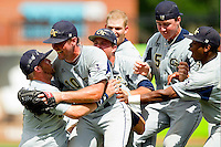 The Georgia Tech Yellow Jackets celebrate on the pitchers mound after defeating the Miami Hurricanes to win the 2012 ACC Baseball Championship at NewBridge Bank Park on May 27, 2012 in Winston-Salem, North Carolina.  The Yellow Jackets defeated the Hurricanes 8-5.  (Brian Westerholt/Four Seam Images)
