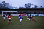 Witton Albion 1 Warrington Town 2, 26/12/2017. Wincham Park, Northern Premier League. First half action at Wincham Park, home of Witton Albion (in red) during their Northern Premier League premier division fixture with Warrington Town. Formed in 1887, the home team have played at their current ground since 1989 having relocated from the Central Ground in Northwich. With both team chasing play-off spots, the visitors emerged with a 2-1 victory, the winner being scored by Tony Gray in second half injury time, watched by a crowd of 503. Photo by Colin McPherson.