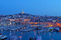 Boats in the marina of the Vieux-Port with Notre Dame de la Garde in the background, Marseille, France..