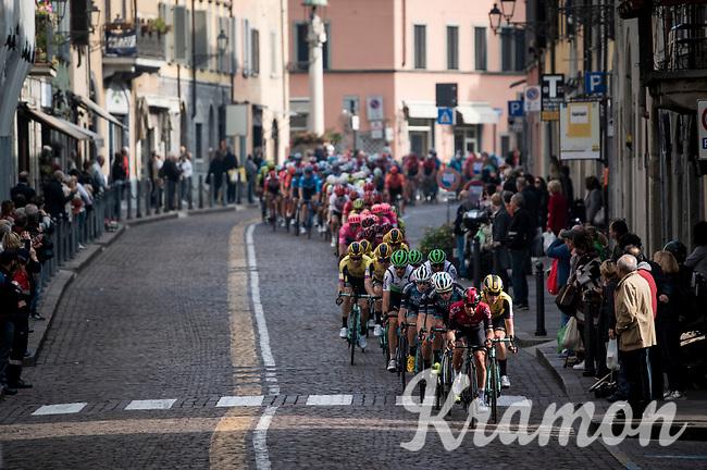 peloton led by Jonathan Castroviejo (ESP/Ineos) rolling through town<br /> <br /> 113th Il Lombardia 2019 (1.UWT)<br /> 1 day race from Bergamo to Como (ITA/243km)<br /> <br /> ©kramon