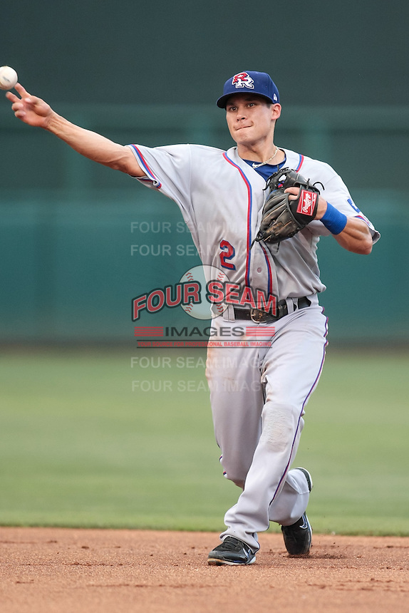 Greg Miclat (2) of the Round Rock Express throws to first base during the Pacific Coast League game against the Oklahoma City RedHawks at Chickashaw Bricktown Ballpark on June 14, 2013 in Oklahoma City ,Oklahoma.  (William Purnell/Four Seam Images)