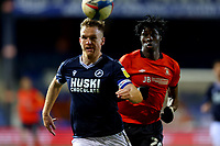 23rd February 2021; Kenilworth Road, Luton, Bedfordshire, England; English Football League Championship Football, Luton Town versus Millwall; Alex Pearce of Millwall breakes forward under pressure from Elijah Adebayo of Luton Town