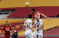Roma's Lorenzo Pellegrini, top, and Genoa's Andrea Masiello, right, jump for the ball during the Italian Serie A Football match between Roma and Genoa at Rome's Olympic stadium, March 7, 2021.<br /> UPDATE IMAGES PRESS/Riccardo De Luca