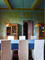The dining room at the Villa Garani with walls decorated by Renzo Mongiardino in collaboration with Lila de Nobili
