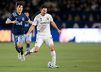 CARSON, CA - MARCH 07: Sacha Kljestan #16 of the Los Angeles Galaxy passes off the ball during a game between Vancouver Whitecaps and Los Angeles Galaxy at Dignity Health Sports Park on March 07, 2020 in Carson, California.